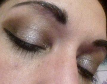 Dark green holo makeup